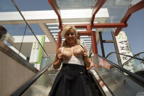 amateur photo Kylie Page going down on an escalator