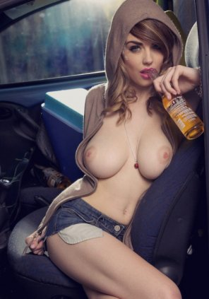 amateur photo A cutie sipping a Corona with her cans out