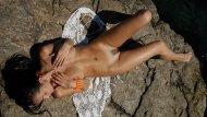 amateur photo Lying on a rock