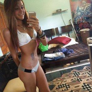 amateur photo Trying to choose a bikini to wear.