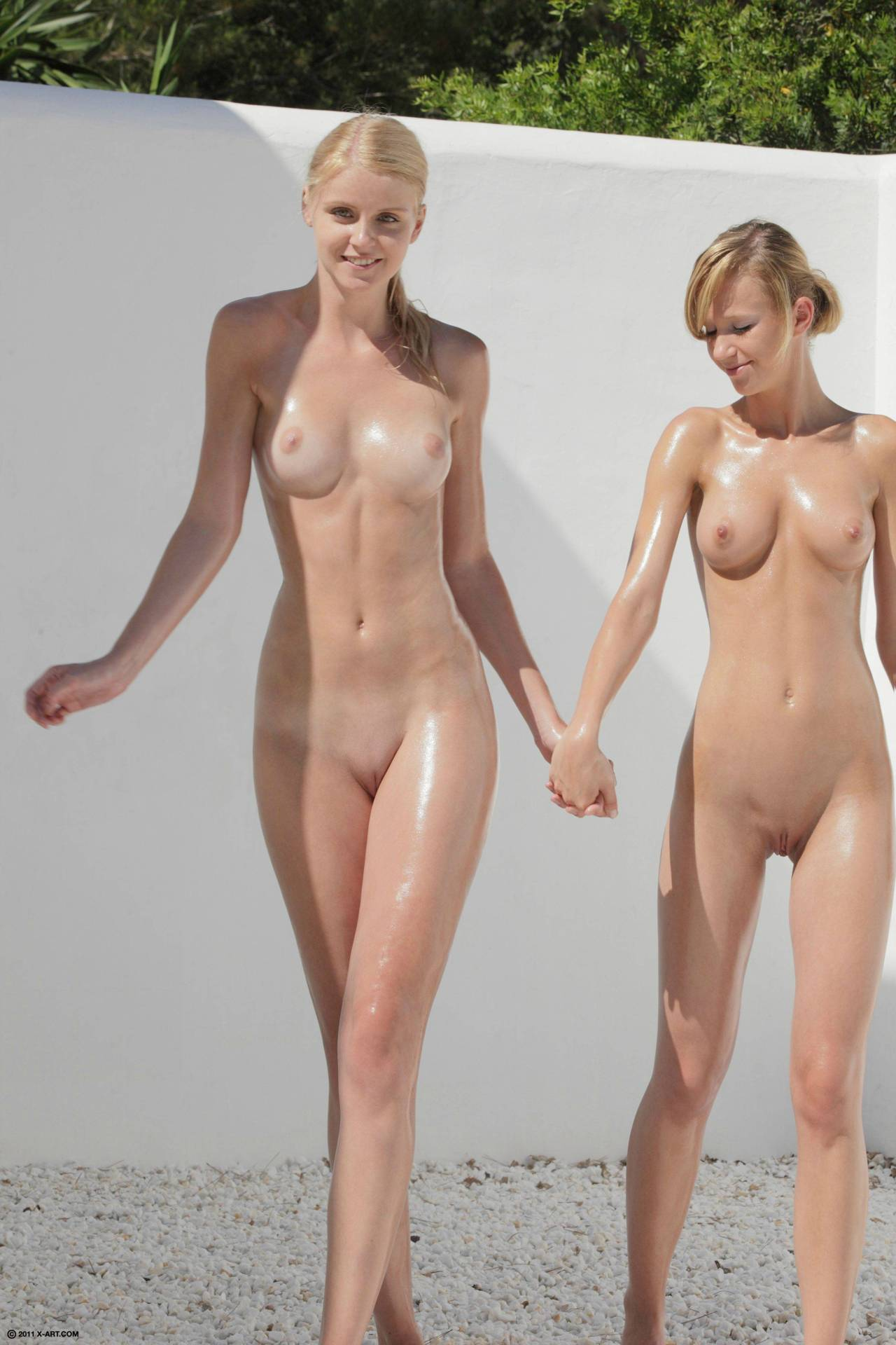 With Nude interracial couple holding hands