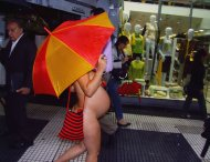 Nude and raining...just strolling down the sidewalk