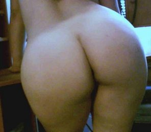 amateur photo Bending over the desk