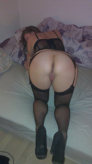 amateur photo in stockings, garter and heels