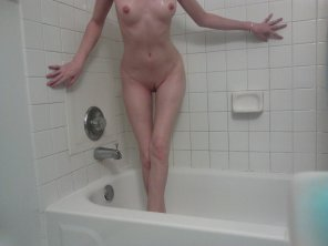 amateur photo oh no she forgot to buy shower curtains when she moved in