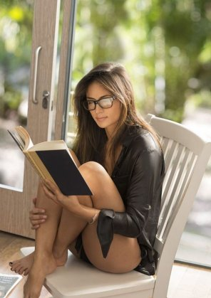 amateur photo Beautiful lady reading