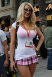 "amateur photo Plaid skirt with ""nerd"" glasses and a shirt so thin you can see her pink bra through it."