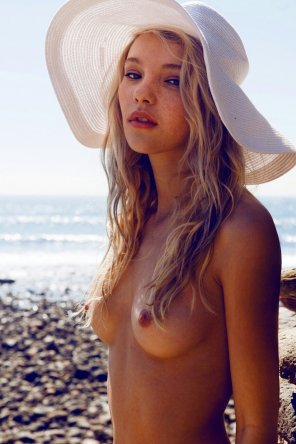 amateur photo Big floppy hat and a bit of lip bite.