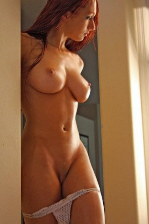amateur photo Slick redhead stunner