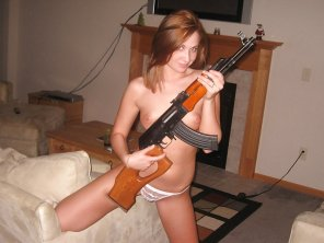 amateur photo Tits...a gun...men love this stuff!