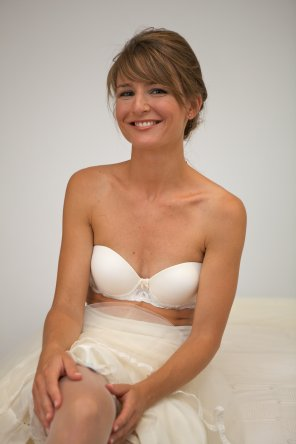 amateur photo Happily embarrassed Bride getting ready in her bra