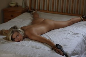 amateur photo Spreadeagled, naked and that look in her eyes says she is ready to be proneboned senseless!