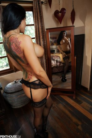 amateur photo Romi Rain enjoying the view in the mirror