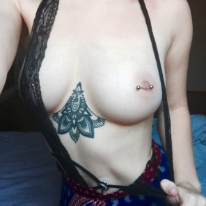 amateur photo Showing one boob