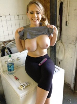 amateur photo Lifting her shirt