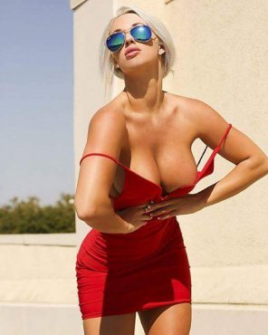 amateur photo Blonde bursting from red dress