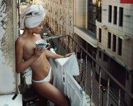 Hanging clothes on her balcony
