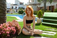 Mia Sollis sitting on the lawn
