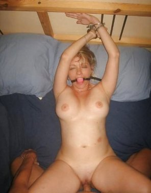 amateur photo Cuffed to the headband, pink ballgag, fucked