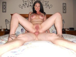 amateur photo He's balls-deep in her ass, and this milf is nothing but smiles
