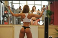 Fit girl in the weight room
