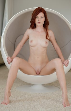 amateur photo hot redhead in a ball chair