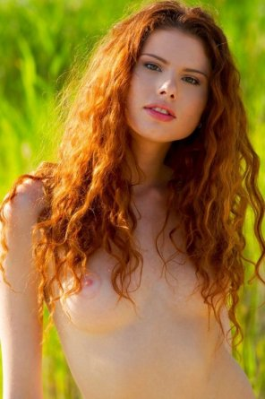 amateur photo Redheaded girl with beautiful curly hair