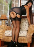 amateur photo Curvy woman in stockings and tight lingerie