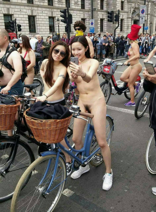 Naked asian girls riding on bike