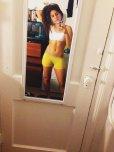 amateur photo yellow yoga shorts.