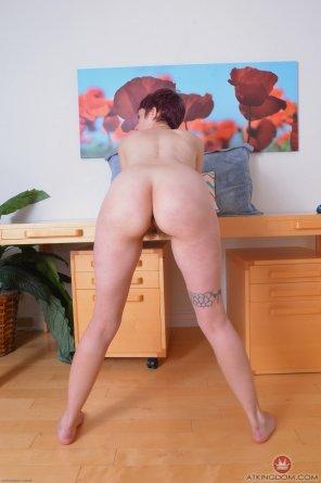 amateur photo Bent over the desk