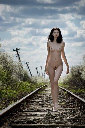 amateur photo Walking down train tracks