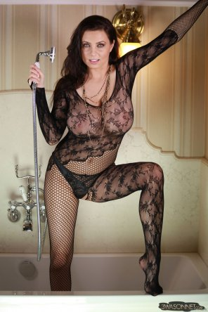 amateur photo Ewa Sonnet dressed in fishnet