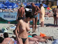 amateur photo Topless at the beach.