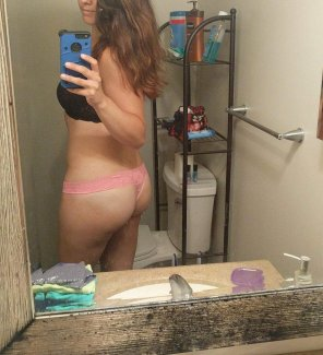 amateur photo Booty in a pink thong.