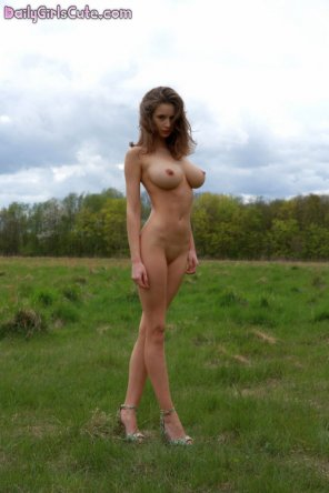 amateur photo Beautiful, busty, petite, and surrounded by nature