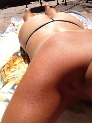 amateur photo Wife working on her tiny tanlines