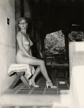 amateur photo B&W of a girl on a stool