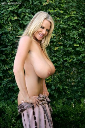 amateur photo Kelly Madison hanging out in her backyard