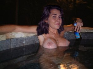 amateur photo She's enjoying a beer while in a hot tub/jacuzzi