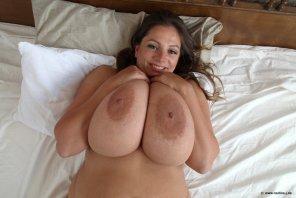 amateur photo On her back.