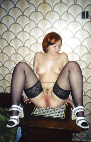 amateur photo Redhead in thigh highs