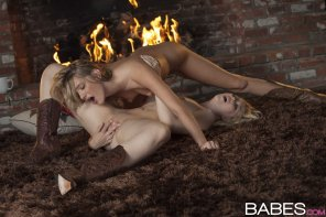 amateur photo Kenna James and Samantha Rone by the fireside