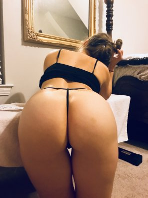 amateur photo Bent over with a tiny bun and gap.