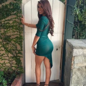 amateur photo Damn Fine Booty In Tight Green Dress