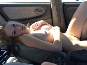 amateur photo laying in her car