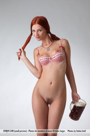 amateur photo Stunning redhead with a huge mug of beer