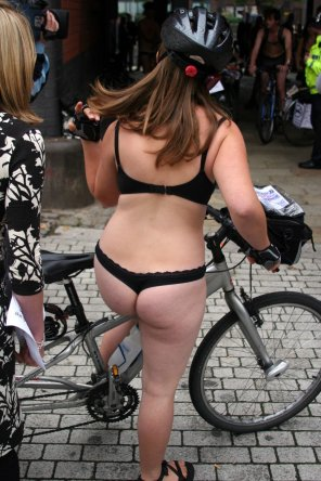 amateur photo Getting on her bicycle in a black thong