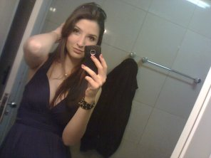 amateur photo Mirror + black dress + little cleavage