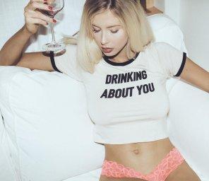 amateur photo Blondie having a drink.